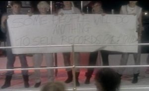Duran Duran Girls On Film band members holding sign