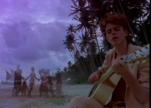 Duran Duran Save a Prayer John Taylor plays guitar on beach