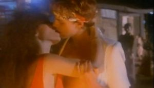 Hungry Like Wolf Duran Duran John Taylor kisses woman