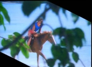 Rio Duran Duran Simon rides a horse on the beach