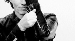 Duran Duran Pressure Off John unzips jacket sleeve