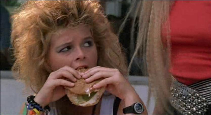 Tuff Turf Ronnie eats a hamburger