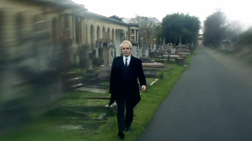 Nick Rhodes hangs out in a cemetery