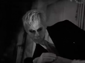 Nick Rhodes drapes himself over furniture